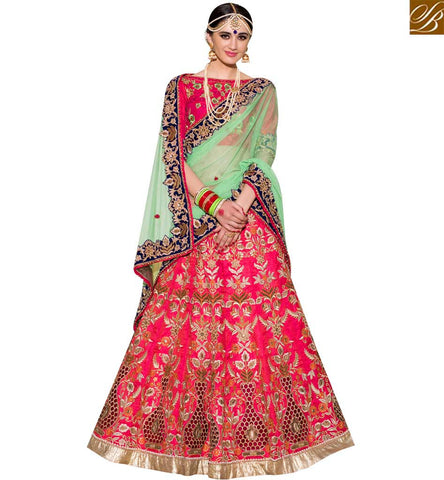 STYLISH BAZAAR DAZZLING PINK AND GREEN NET SILK DESIGNER LEHENGA CHOLI WITH EMBROIDERY SLPRG4017