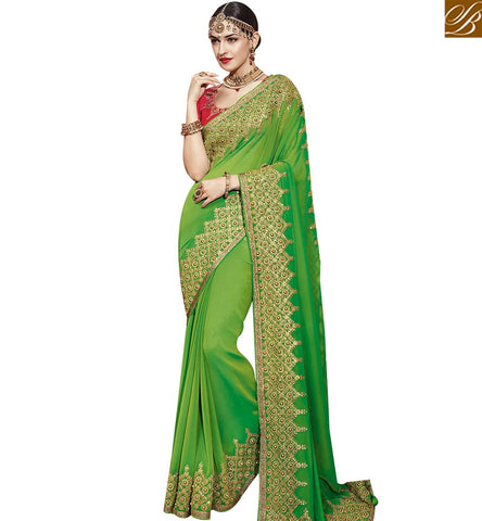 STYLISH BAZAAR DAZZLING GREEN SATIN GEORGETTE HAVING LOVELY BORDER WORK DESIGNER SAREE WITH DIAMOND WORK SLTHS715