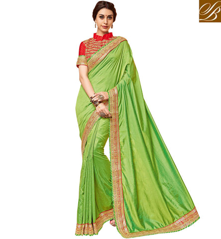 STYLISH BAZAAR Parrot green saree in India, UK, US with red collared blouse online VDDAN22170