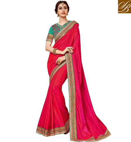STYLISH BAZAAR Latest tomato red single colour saree with green designer blouse online VDDAN22177