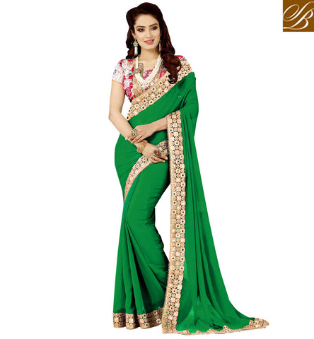 STYLISH BAZAAR DARK GREEN SAREE AND BRIGHT PINK BLOUSE LATEST DESIGN OF SAREES IN SUMMER VDEXZ21075