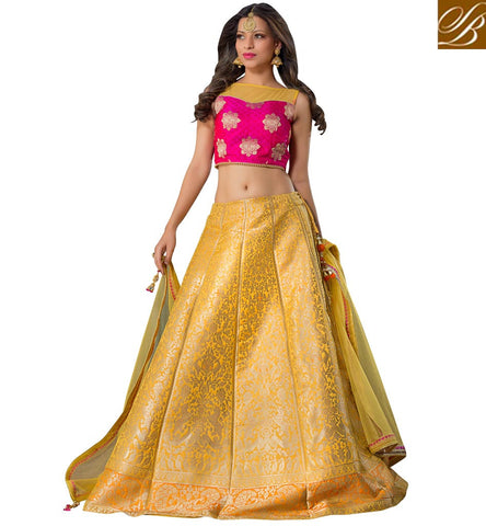 STYLISH BAZAAR Shop pink & yellow sleeveless silk choli with golden yellow lehenga VDGUN22332