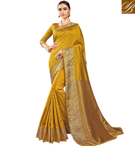 STYLISH BAZAAR Mustard yellow single color heavy border silk sari with matching blouse VDSME22450