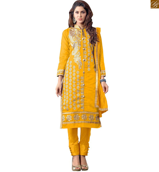 TEMPTING EVER-STYLISH SUITS DESIGN OF WONDERFUL 2015 BEST AND LATEST FASHION CASUAL WEAR FOR WOMEN   DARK YELLOW FLORAL STYLE EMBROIDERED SALWAR SUIT FOR FASHION FOLLOWING FEMALES