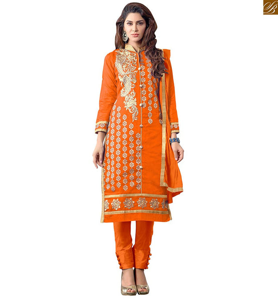 GLAMOROUS PATTERNED NEW SALWAR KAMEEZ DESIGNS COLLECTION OF PUNJABI SALWAR SUITS ONLINE INDIA   MAGNIFICENT EMBROIDERED ORANGE KAMEEZ  WITH TIGHT PANT TYPE SALWAR AT MOST REASONABLE RATE