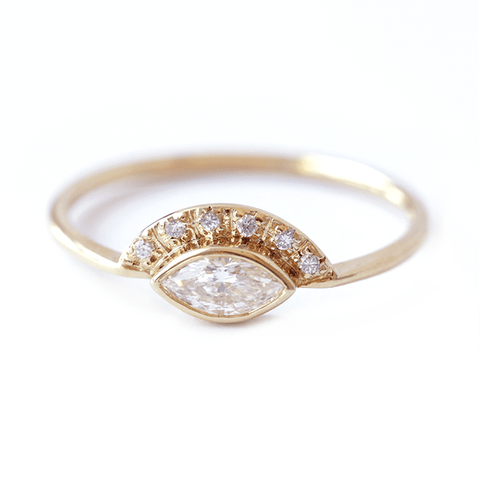 https://www.artemerstudio.com/collections/engagement/products/marquise-diamond-engagement-ring-with-pave-diamonds-crown-0-25-carat-marquise-diamond-18k-solid-gold