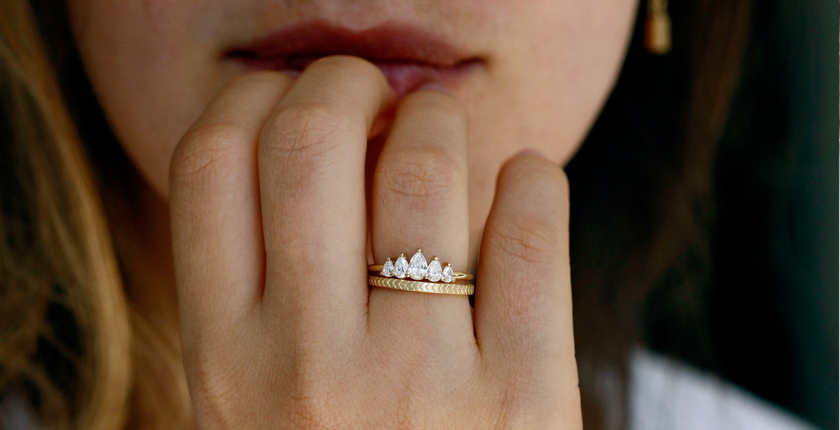 cluster engagement ring with five pear cut diamonds