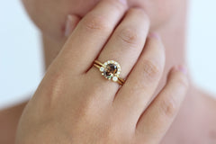 1.5 carat champagne diamond engagement ring on a hand in a set