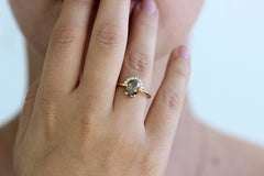 1.5 carat champagne diamond engagement ring on ring finger