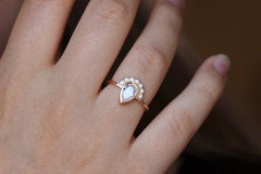 Pear Diamond Engagement Ring on finger