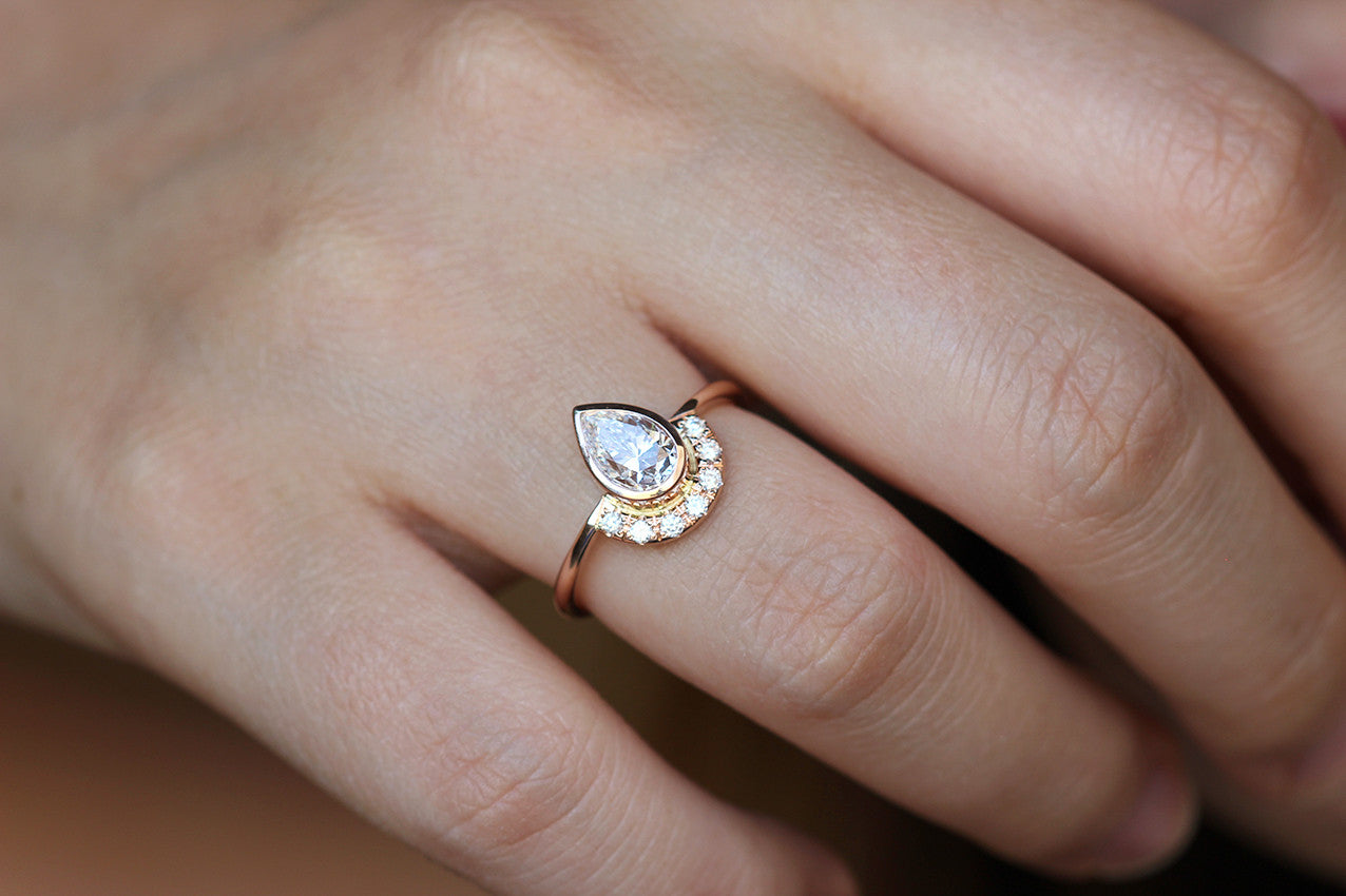 Rose Gold Engagement Ring on finger