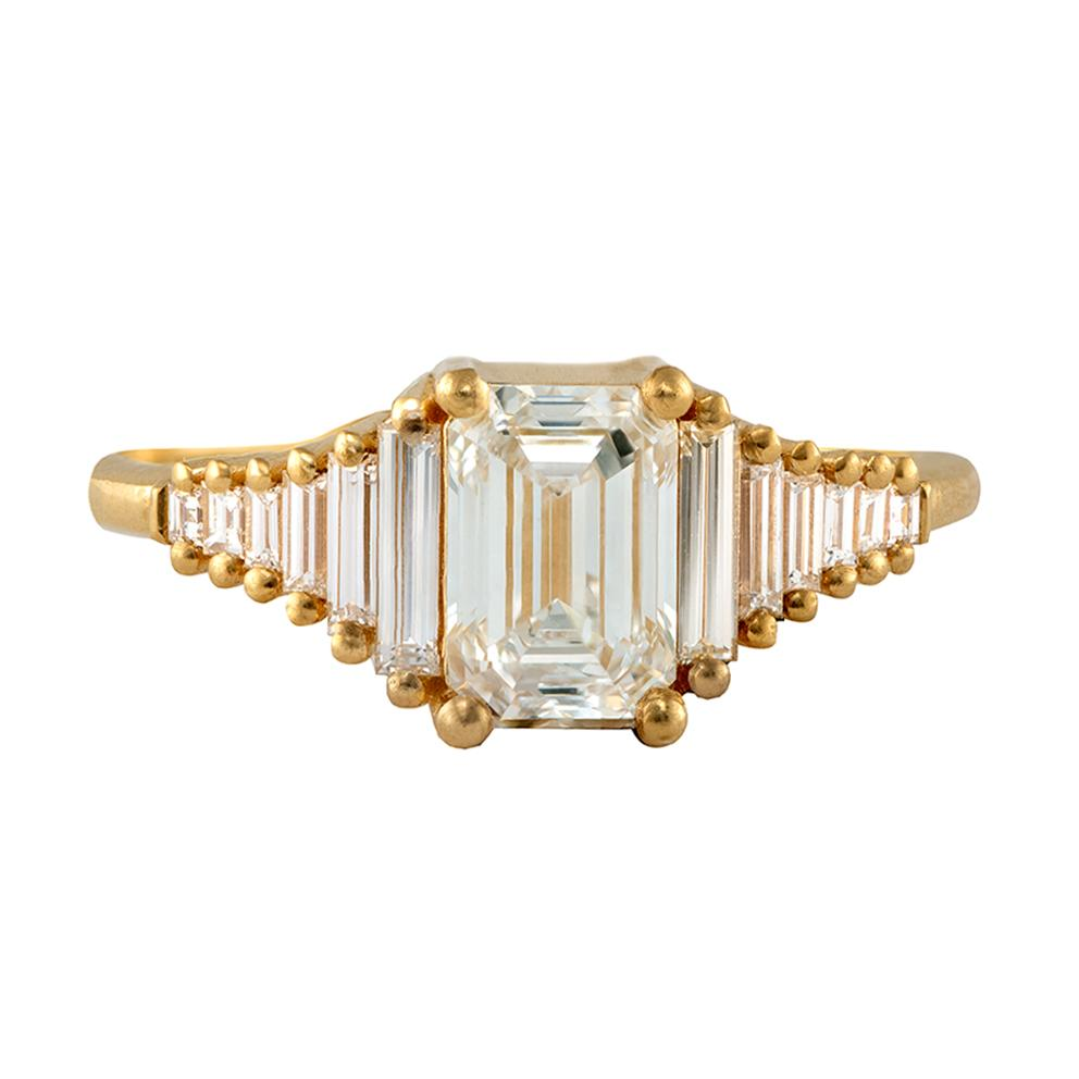 classic Emerald-cut engagement ring with tapered needle baguette diamonds