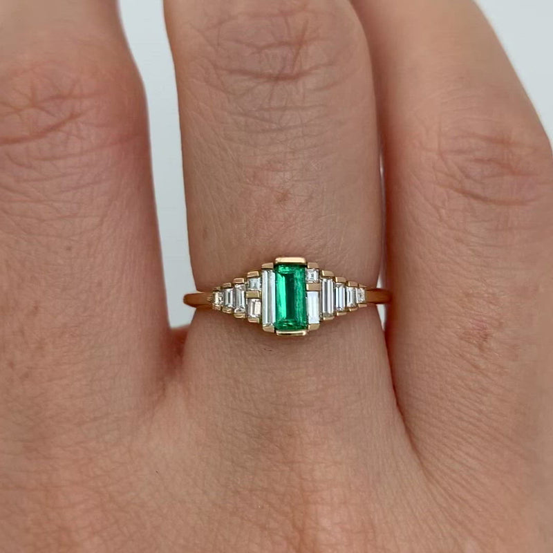 Dainty-Emerald-Engagement-Ring-with-Needle-Baguette-Diamonds-closeup-video