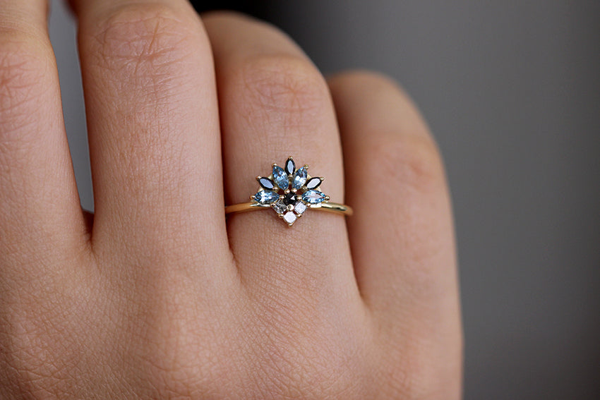 Aquamarine Engagement Ring On Woman's Finger