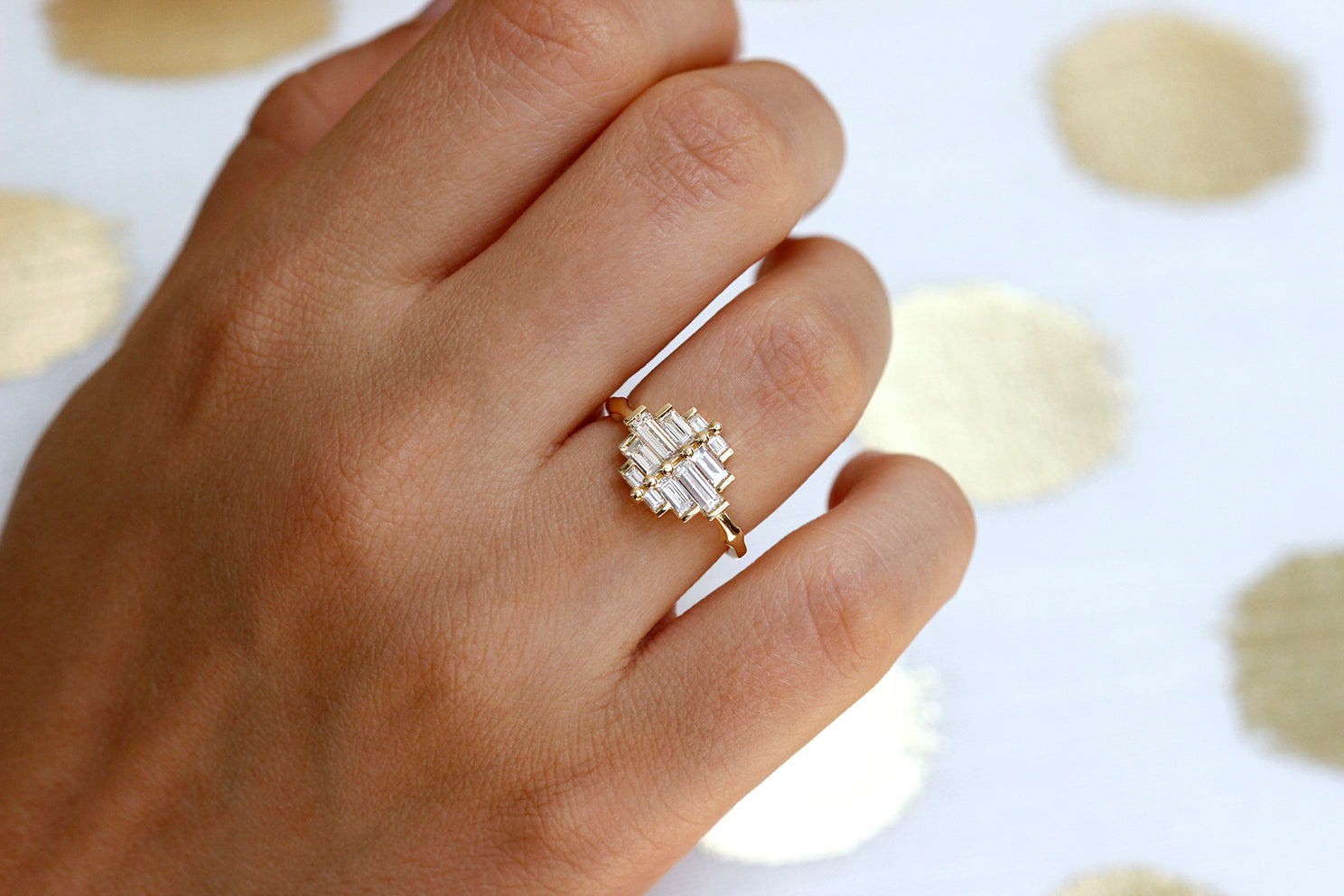 Art Deco Baguette Cluster Engagement Ring On Finger