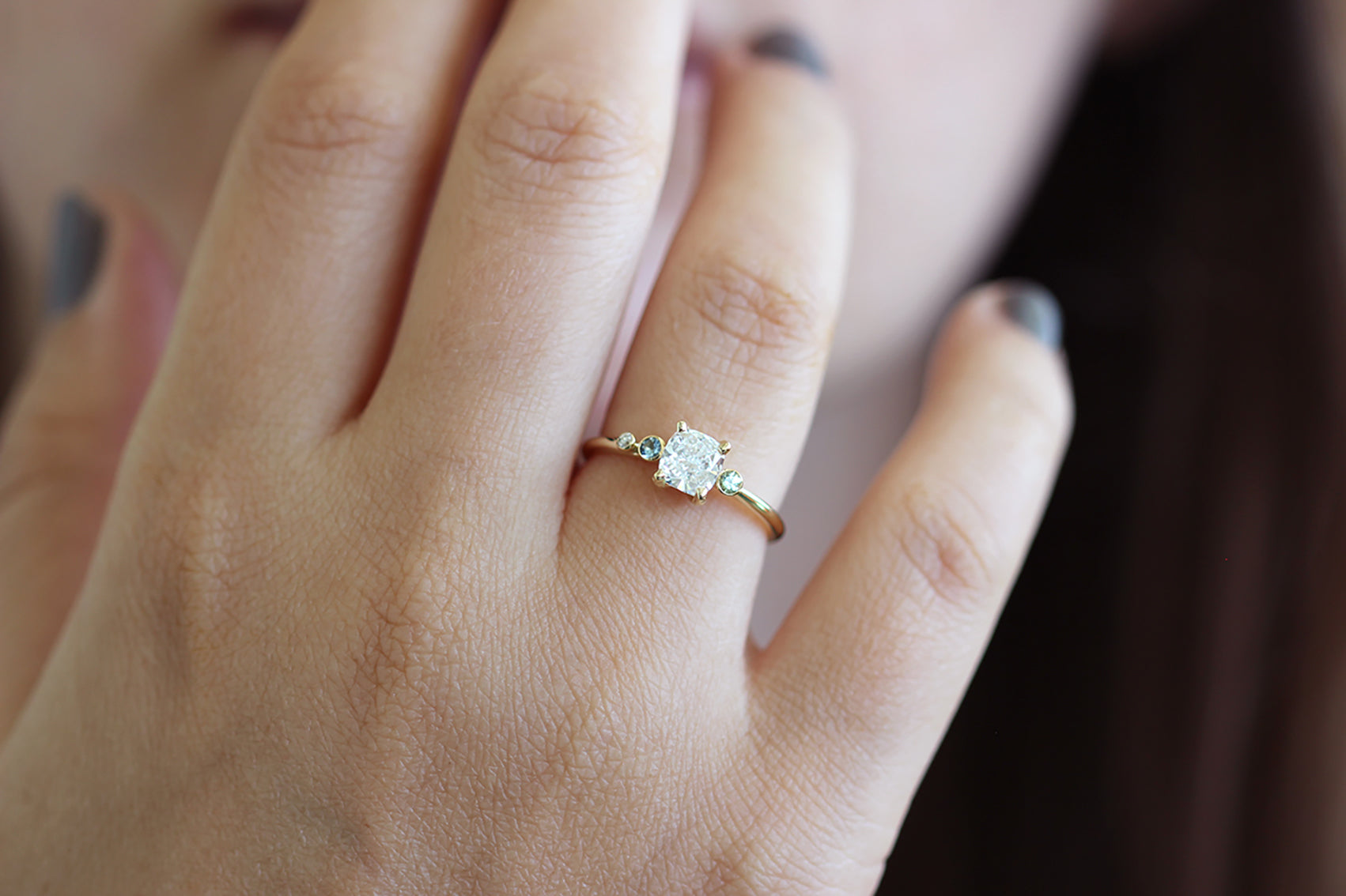 Close Up Of Asymmetric Diamond Cluster Engagement Ring with Aquamarine And Mint Garnet