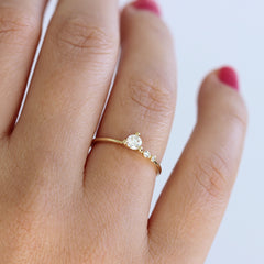 Asymmetric Diamond Engagement Ring - 0.2 Carat Round Diamond on hand up close view