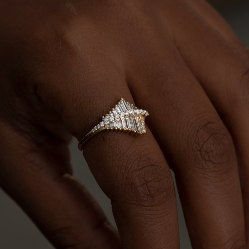 Asymmetrical-Baguette-Cluster-Ring-with-Round-Diamond-Beams-side-shot