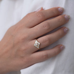 Star Diamond Engagement Ring with White Pearl on shirt
