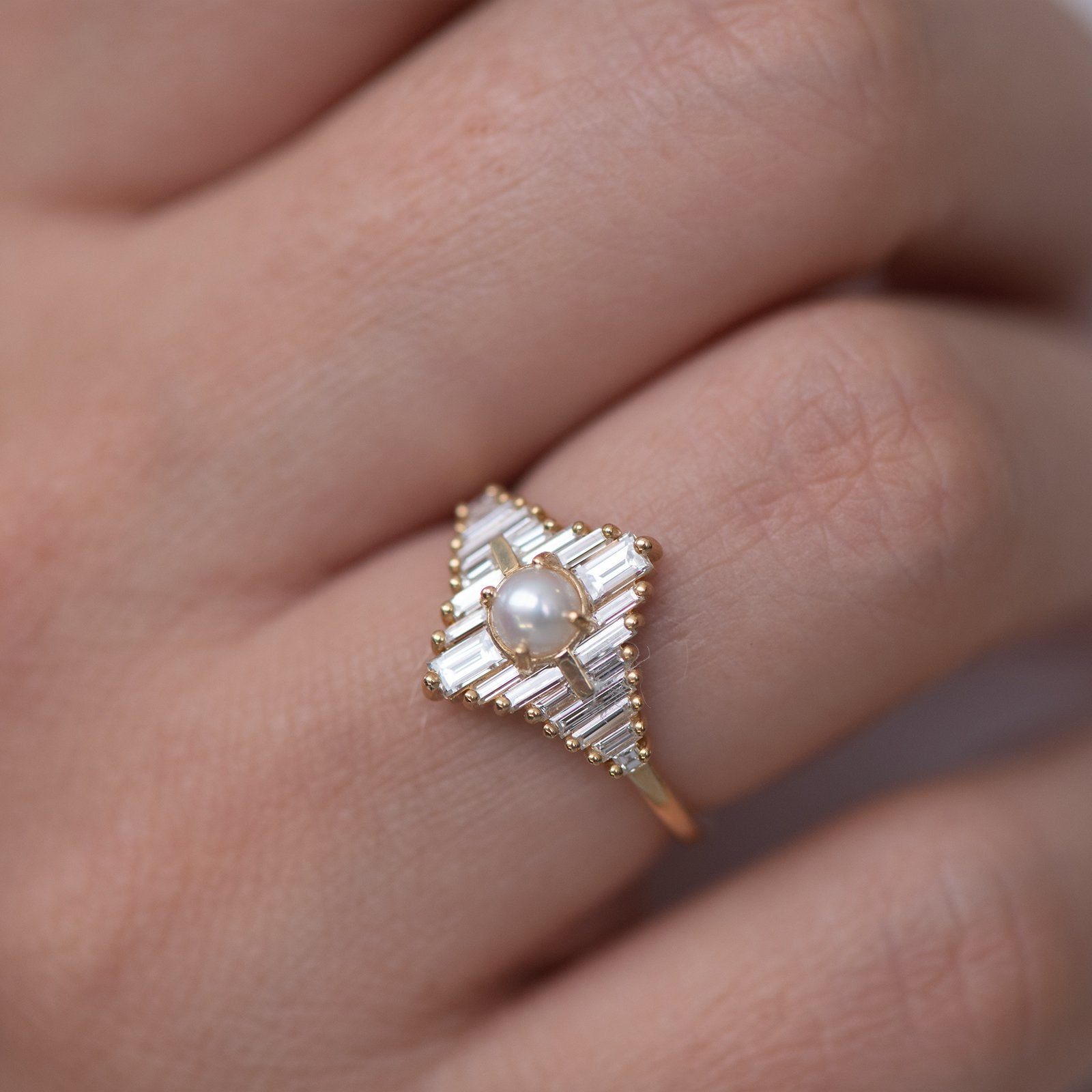 Star Diamond Engagement Ring with White Pearl on finger