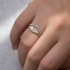 Half Moon Diamond Wedding Ring Set on tabel