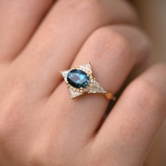 Teal Sapphire Deco Ring with Triangle Diamonds on finger.jpg