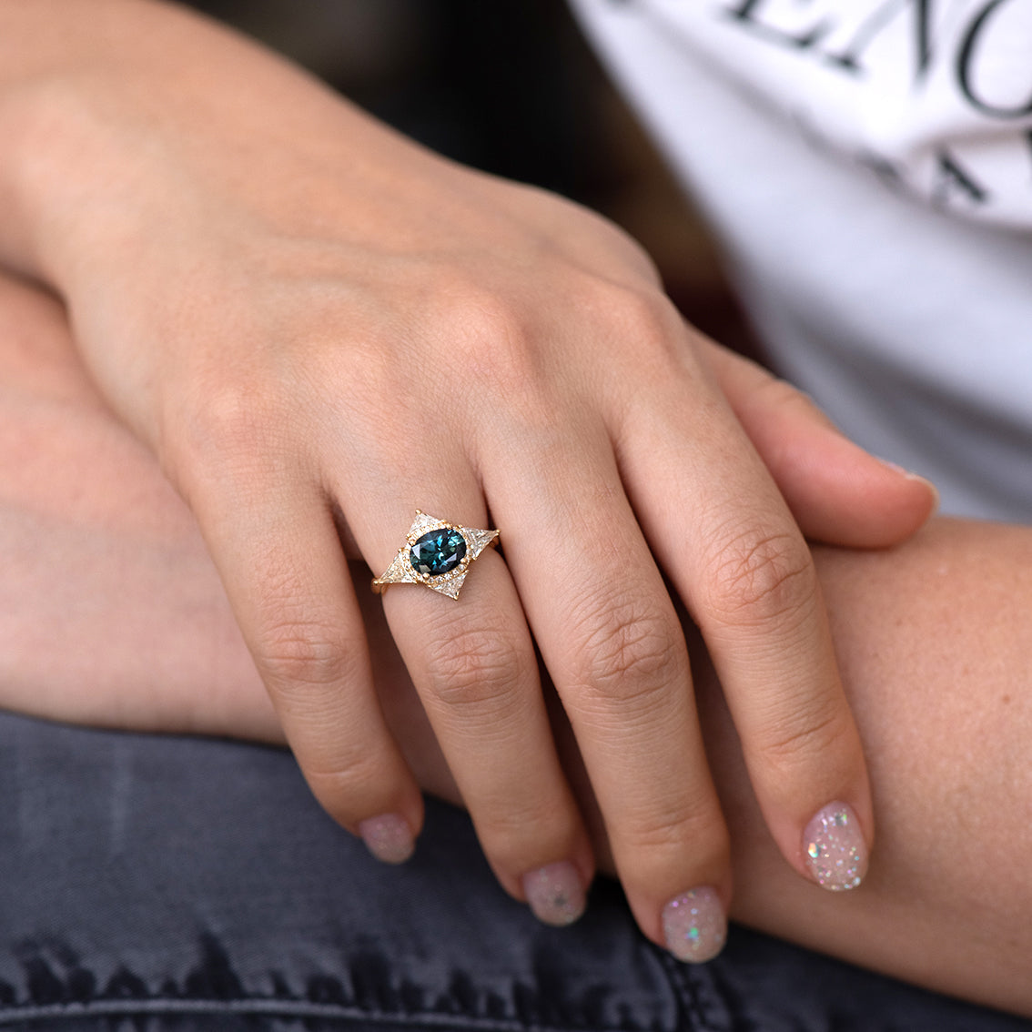 Teal Sapphire Deco Ring with Triangle Diamonds on hand