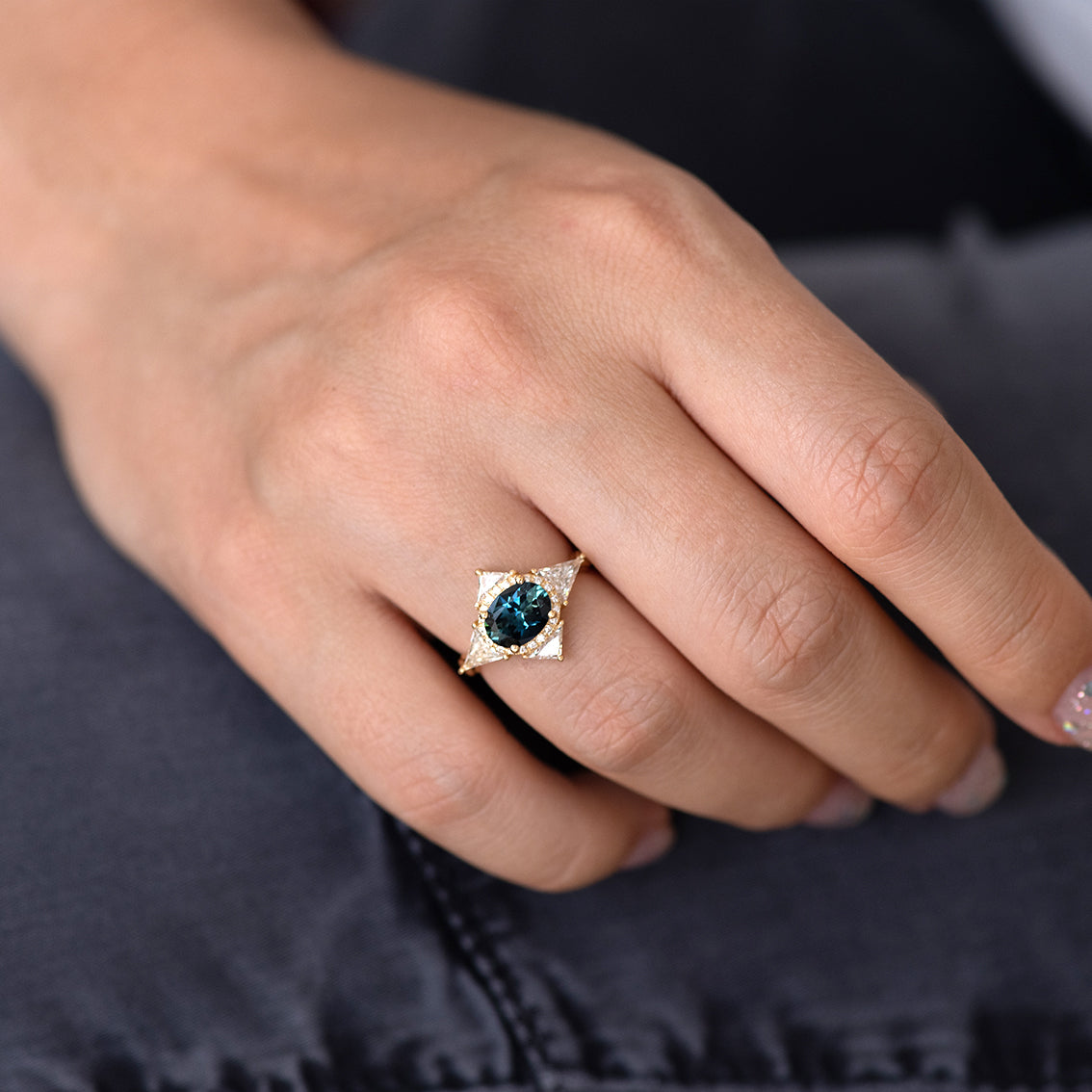 Teal Sapphire Deco Ring with Triangle Diamonds on jeans.jpg