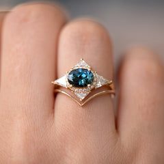 Teal Sapphire Deco Ring with Triangle Diamonds on middle finger.jpg
