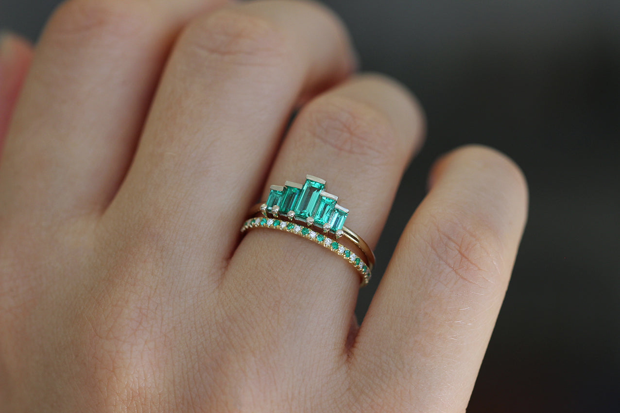 Baguette Cut Emeralds Engagement Ring In A Set On Finger