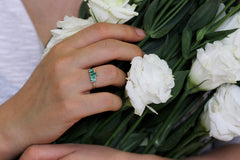 Baguette Cut Emeralds Engagement Ring On Hand