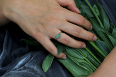 Baguette Cut Emeralds Engagement Ring On Ring Finger