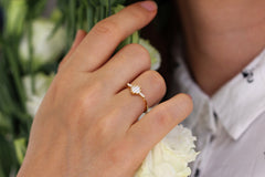 Baguette Diamond Cluster Engagement Ring On Finger