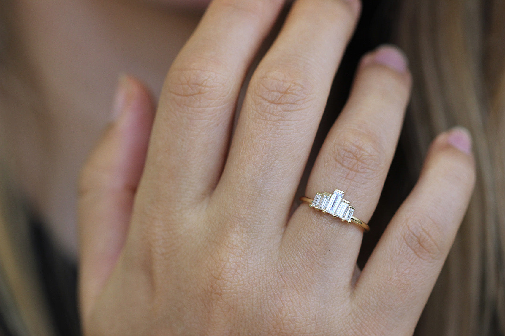 Baguette Engagement Ring On Finger