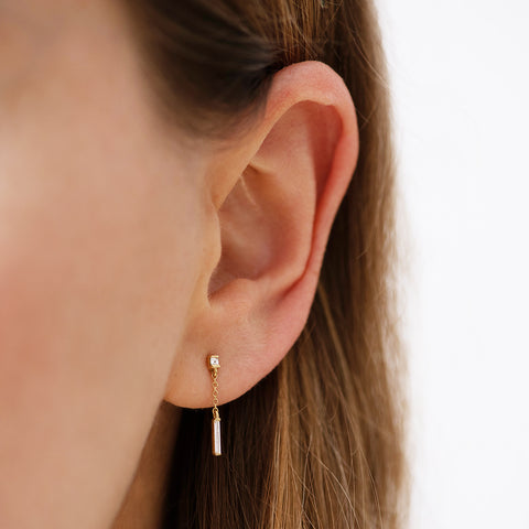 Baguette Diamond Drop Earrings on Ear Up Close