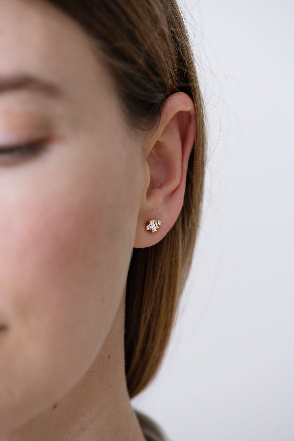 Baguette Diamond Earrings on Ear Front Shot