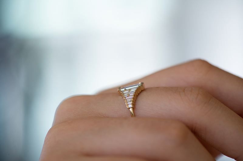 Baguette Diamond Ring with Gradient Diamonds and Gold Details on Hand side view