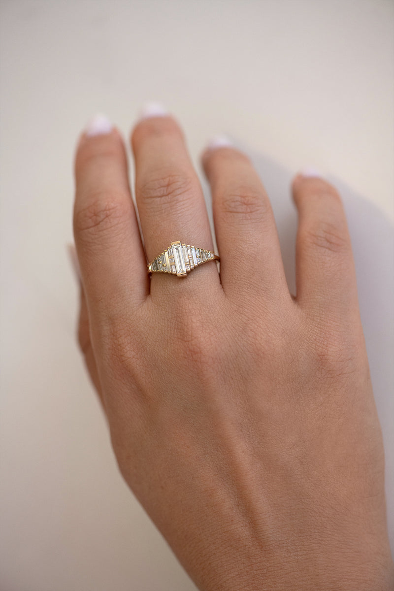 Baguette Diamond Ring with Gradient Diamonds and Gold Details on Hand top view