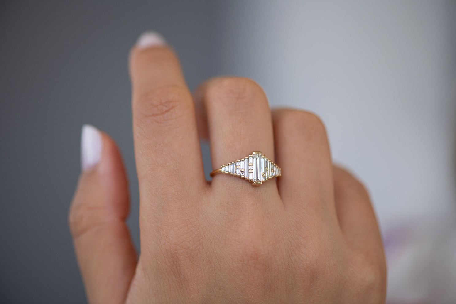 Baguette Diamond Ring with Gradient Diamonds and Gold Details on Hand other angle