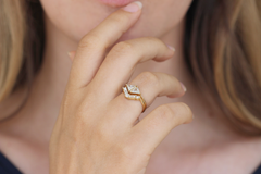 Delicate chevron shaped wedding ring On Finger