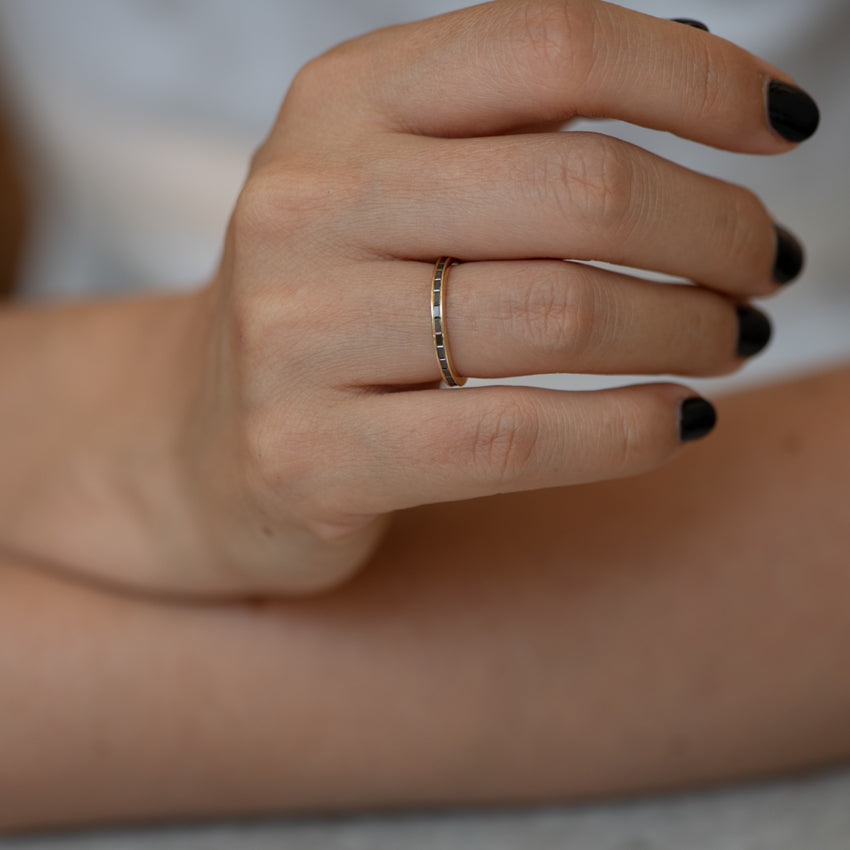 Black-Baguette-Diamond-Eternity-Ring-Black Wedding-Band-Ring-on-finger