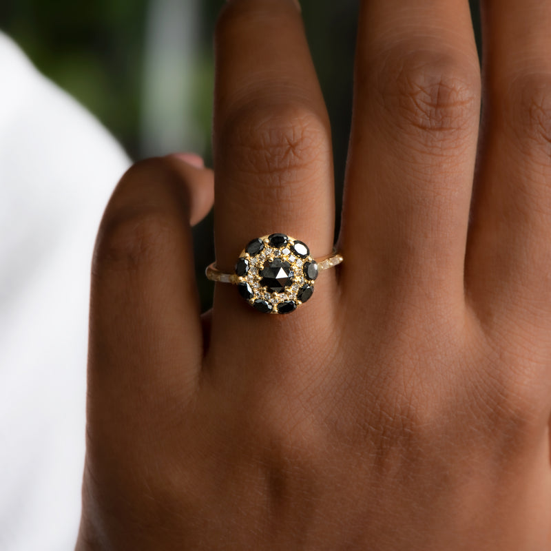 Black-Diamond-Mandala-Engagement-Ring-With-Baguette-Diamond-Band-glistening-