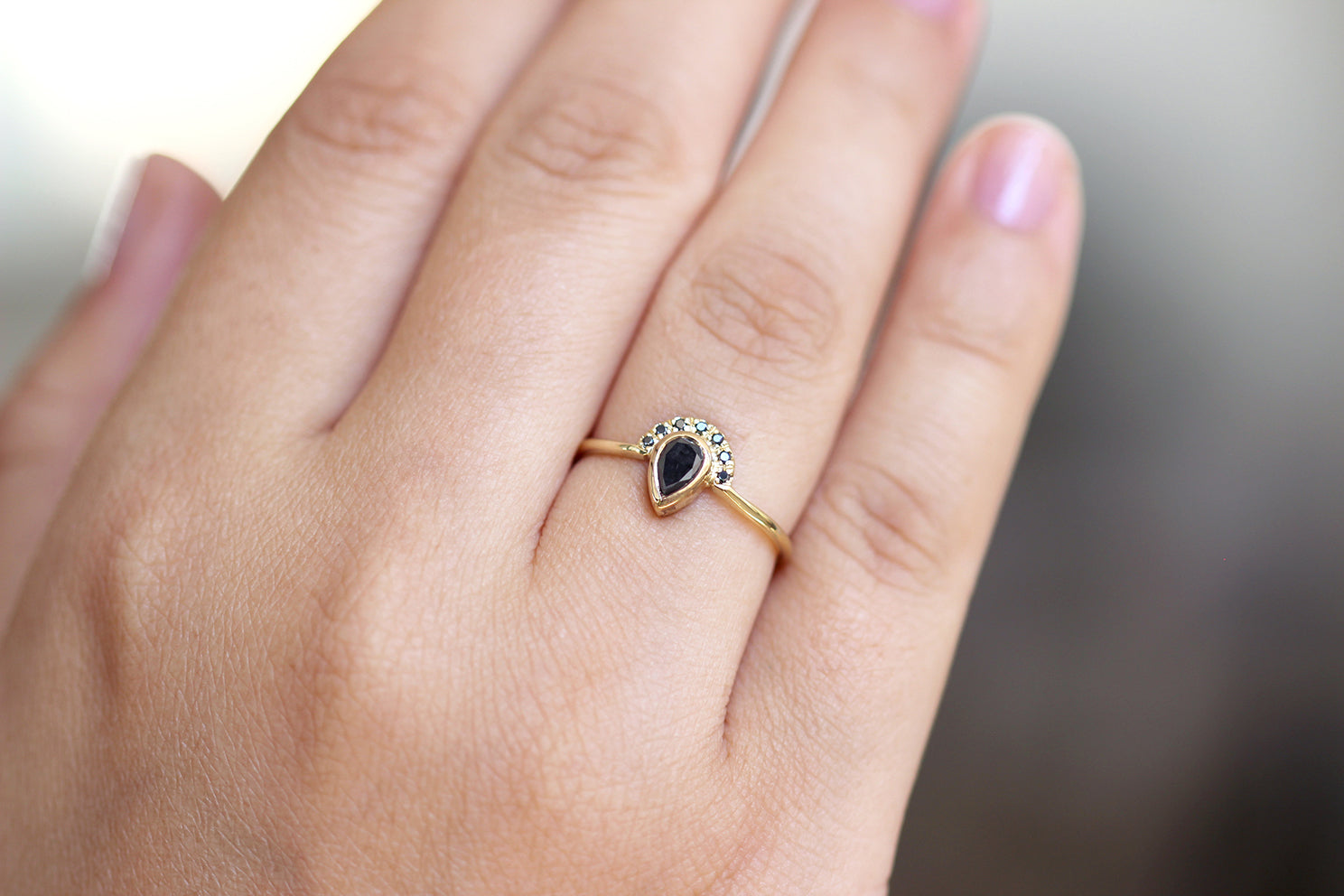 Black Pear Diamond Engagement Ring with Half Diamond Halo alternate angle on hand