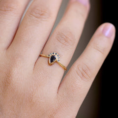 Black Pear Diamond Engagement Ring with Half Diamond Halo on hand front shot