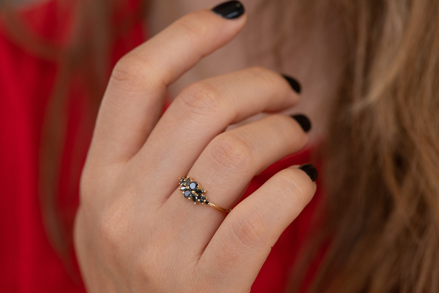 Black Diamond Flora Engagement Ring on Hand Side Angle