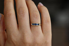 Blue Sapphire Baguette Engagement Ring On Finger