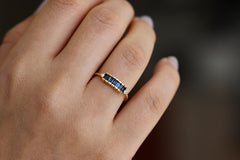Blue Sapphire Baguette Engagement Ring On Hand