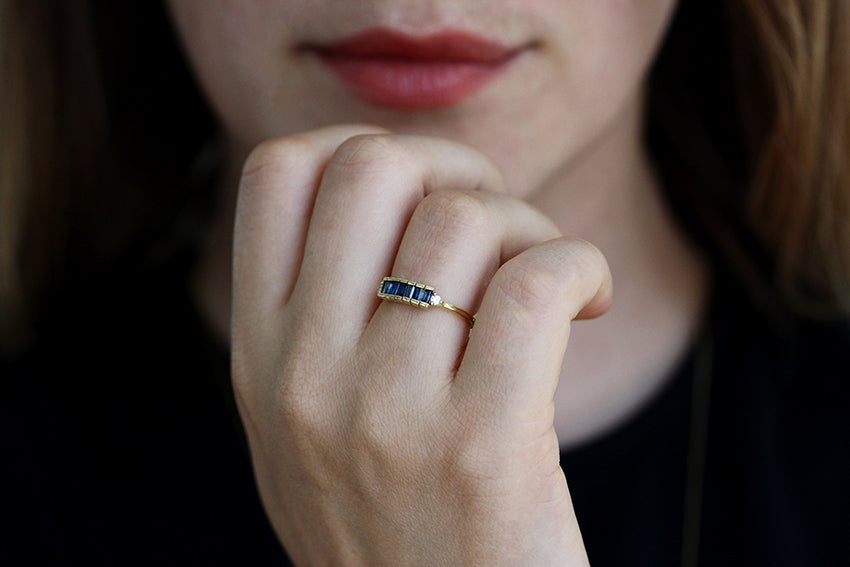 Blue Sapphire Baguette Engagement Ring On Woman's Finger