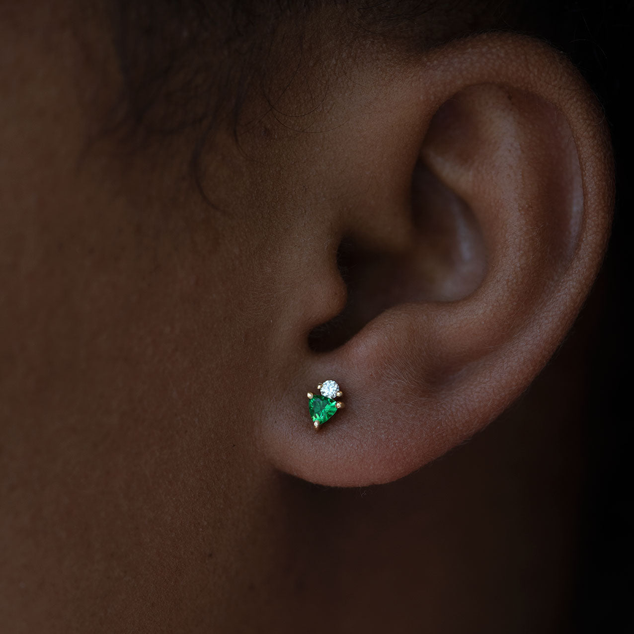 Bright Green Tsavorite Stud Earrings with Diamonds on model