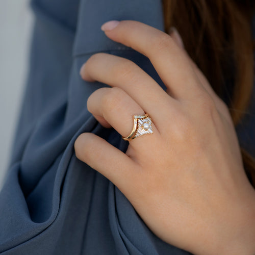 Chevron-Wedding-Ring-with-Baguette-and-Princess-Diamonds-on-finger